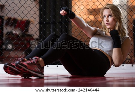 Horizontal view of sit-ups during female training - stock photo
