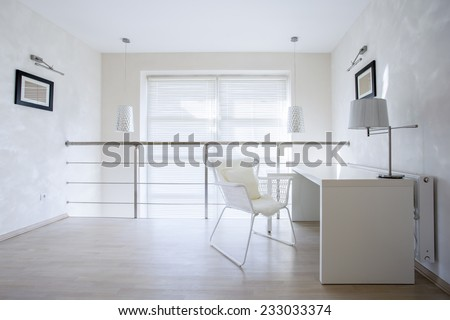 Horizontal view of small private office at home - stock photo
