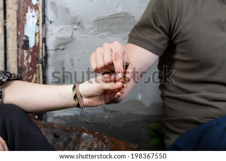 Horizontal view of smoking marijuana after school - stock photo