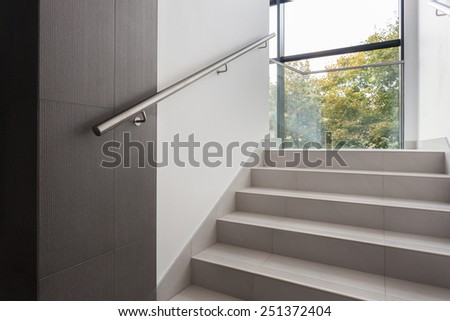 Horizontal view of stairs in office building - stock photo