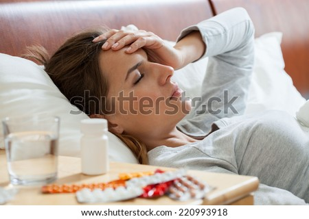 Horizontal view of woman suffering from flu - stock photo