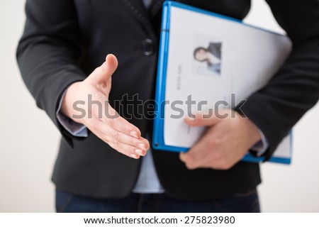 Horizontal view of woman with her curriculum vitae - stock photo