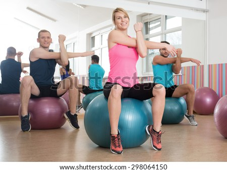 Horizontal view of workout with fitness balls