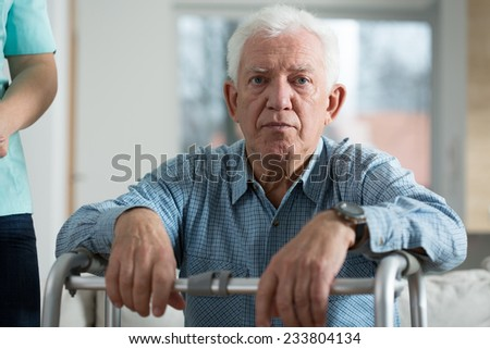 Horizontal view of worried disabled senior man - stock photo