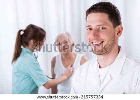 Horizontal view of young doctors during their job - stock photo