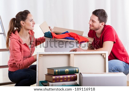 Horizontal view of young marriage packing stuff - stock photo