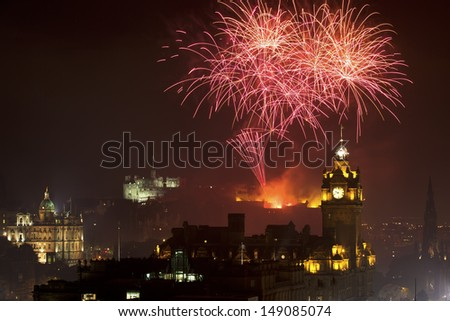 Horizontal view on Edinburgh castle with fireworks - stock photo
