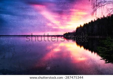 Horizontal vintage sunset on mountain lake background backdrop - stock photo