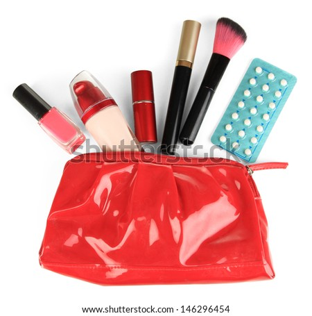 Hormonal pills in women's make-up bag isolated on white - stock photo