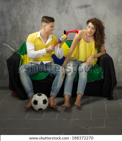 horn on ear in a football supporter family - stock photo