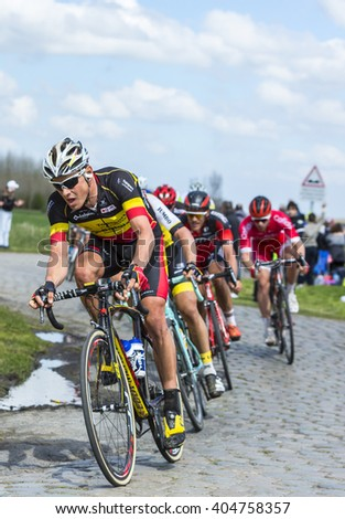 HORNAING,FRANCE-APR 10: The Belgian cyclist Preben Van Hecke of Direct Energie Team riding in the peloton on a paved road in Hornaing, France during Paris Roubaix on 10 April 2016.
