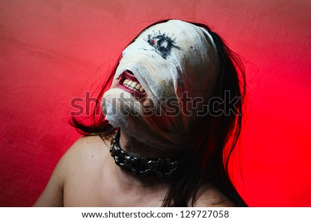 Horrible guy with scary mouth and one eye, extreme body-art - stock photo