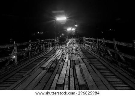 Horror bridge.The blurry image of old wooden bridge. Processed by add noise and grain  to looked horror mode. - stock photo