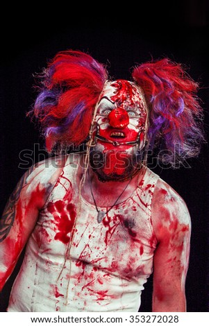 Horror clown. Bloody freak.