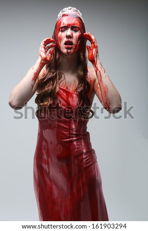 Horror Image of a Woman Dripping in Blood Wearing Prom Dress - stock photo