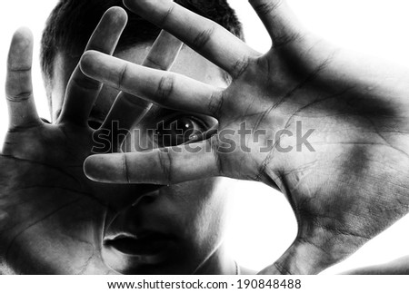 Horror. Man emotionally shocked. Focus point on forward hand - stock photo