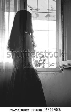 Horror Scene of a creepy Woman - stock photo