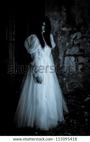 Horror Scene of a Scary Woman. Film noir style. - stock photo