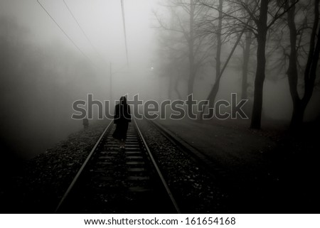 Horror scene of a scary woman in black dress - stock photo
