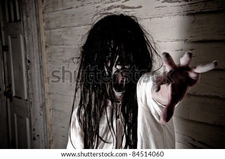Horror Scene of a Woman Possessed Screaming - stock photo