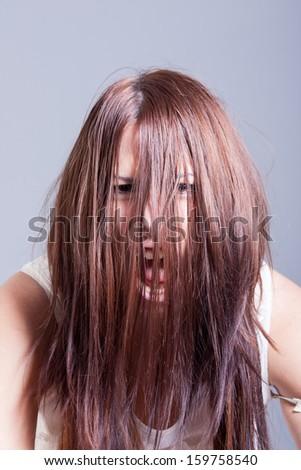 horror scene of woman possessed - stock photo