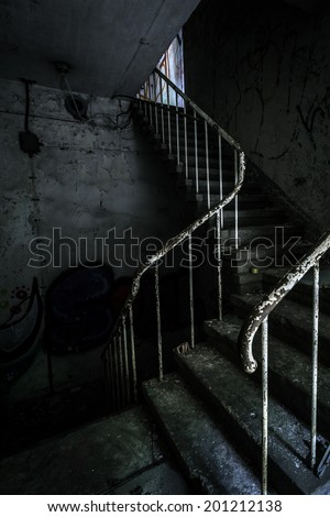 Horror staircase and hidden creepy hand - stock photo