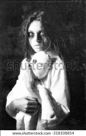Horror style shot: the mysterious ghost girl with moppet doll in hands. Grunge texture effect - stock photo