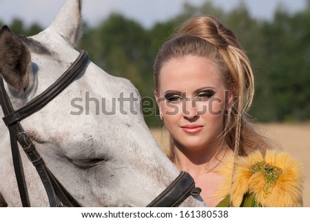 Horse and butiful woman face to face - stock photo