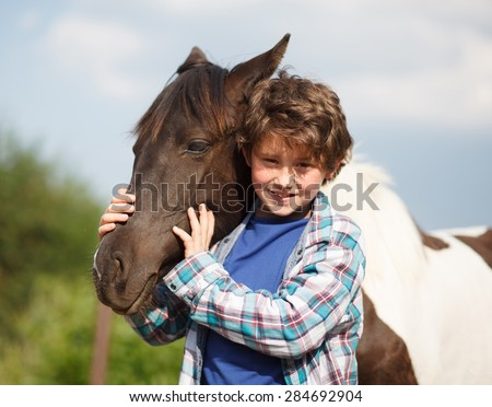 Horse and Jockey - Little boy and little horse - best friends - stock photo