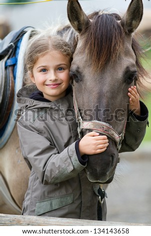 Horse and lovely girl equestrian - stock photo