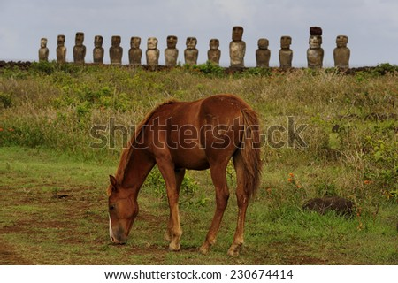 Horse and Moais in Easter Island, Chile - stock photo