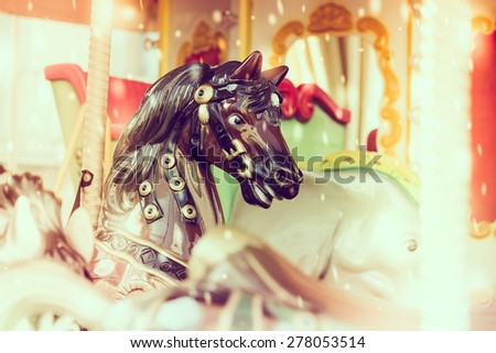 Horse carousel carnival - vintage effect and light leak effect - stock photo