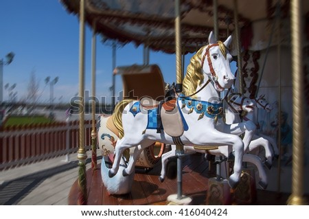 Horse  carousel in a holiday park - stock photo