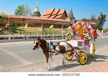 horse carriage in temple Phrathat Lampang Luang in Lampang, Thailand - stock photo