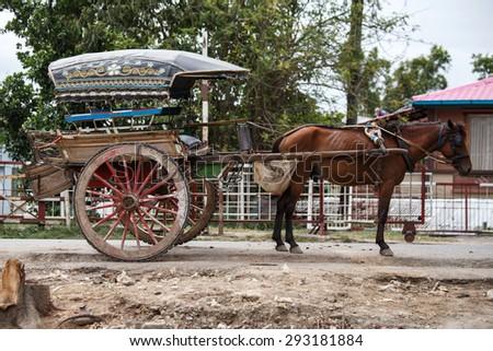 Horse Cart inAmarapura town on the outskirts of Mandalay City in Myanmar (Burma) - stock photo