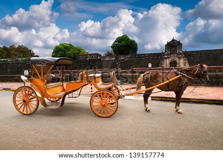 Horse Drawn Carriage parking in front of Fort Santiago.Fort Santiago is a citadel which was first built by Spanish conquistador for the new established Intramuros city of Manila , Philippines.