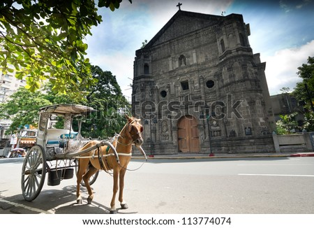 Horse Drawn Carriage parking in front of Malate church , Manila Philippines
