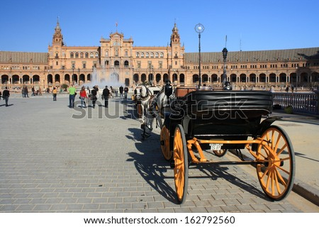 horse-driven carriage with tourists at Plaza de Espana in Seville - stock photo
