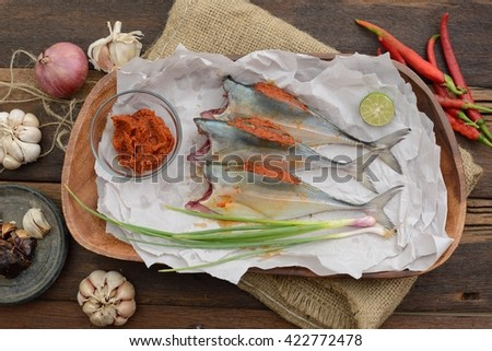 Horse mackerel with chili as ingredient is ready to cook. - stock photo