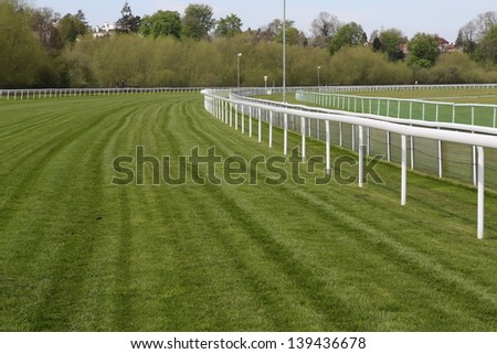 Horse racecourse rails and track - stock photo