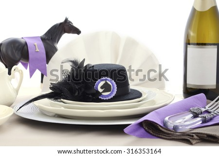 Horse racing Ladies Luncheon fine dining table setting with small black fascinator hat, decorations and champagne.  - stock photo