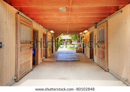 Horse ranch in Washington State with large barn with stables.