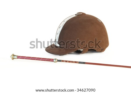 Horse riding helmet and crop - stock photo
