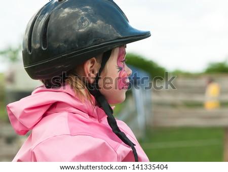 Horse riding - little jockey is riding a horse - stock photo