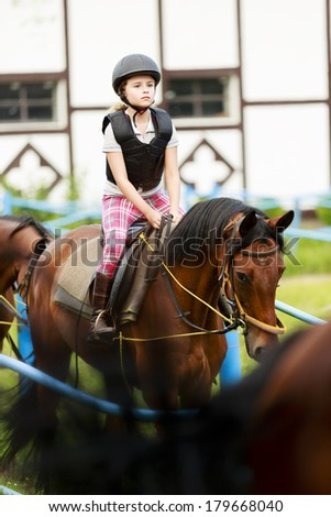 Horse riding, portrait of lovely equestrian on a horse - stock photo