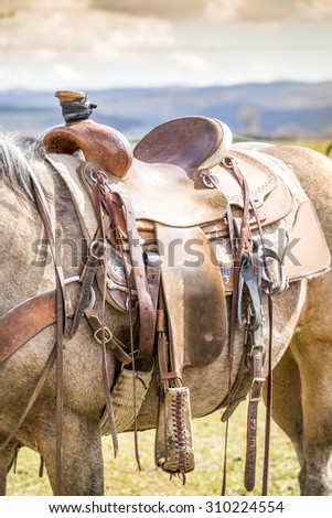 Horse saddle on the American ranch - stock photo