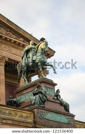 Horse sculpture at the door of the Alte Nationalgalerie in Berlin, Germany - stock photo