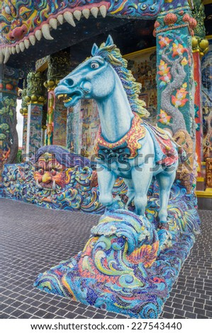Horse sculpture was decorated with glazed tile of the sanctuary in Ban Rai temple, Korat, Thailand - stock photo