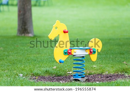 horse seesaw on a playground - stock photo