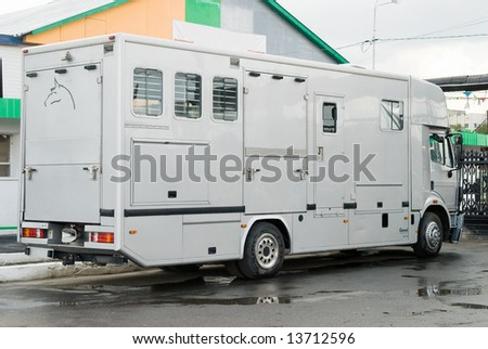 Horse van for transportation at hippodrome - stock photo